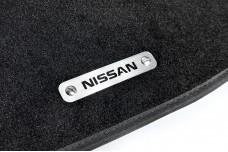 Car mat badge for Nissan